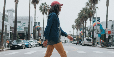 Lady walking down a street in California