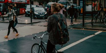 Woman riding bike on London street
